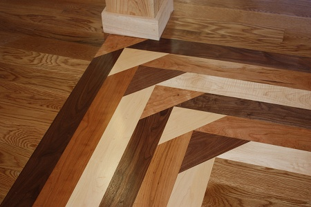 Hardwood Floor Inlays a flooring installer that is experienced also make sure you call references this is a high priced design feature you do not want to regret hiring Custom Inlays